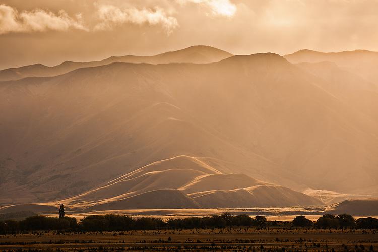 Sunlight on hill country.Seen from the Tekapo - Pukaki Canal near Tekapo, South Island, New Zealand - stock photo, canvas, fine art print