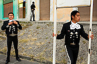"PUEBLA, MEXICO - DEC 7: Mariachis from the group, ""Mariachi Juvenile,"" wait for their next gig at the Mariachi market, ""El Alto,"" in Puebla, Mexico.  This neighborhood--one of two designated for Mariachis in Puebla--is filled with offices and studios of the traditional Mexican bands, and is open 24 hours a day, 7 days a week, so that customers can hire Mariachis whenever the urge arises. (Photo by Landon Nordeman)"