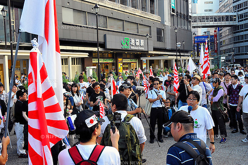 September 29th, 2012 : Tokyo, Japan - Protesters gathered up after their demonstration against China that its people had had demonstrations against Japan due to the territorial dispute of Senkaku Islands, at Ikebukuro Station, Toshima, Tokyo, Japan on September 29, 2012. Even though it was the 40th anniversary day of restoration of diplomatic ties between Japan and China, approximately 300 protesters showed up against the country, according to a demonstration authority. (Photo by Koichiro Suzuki/AFLO)