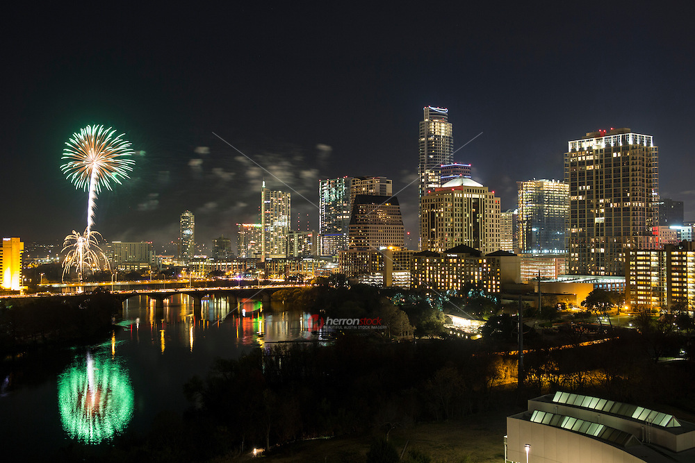 Revelers start ringing in the New Year with a spectacular fireworks display over the downtown Austin skyline and Lady Bird Lake.