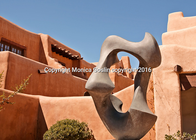 "New Mexico Museum of Art with a sculpture in front by Allan Houser called ""Migration"""