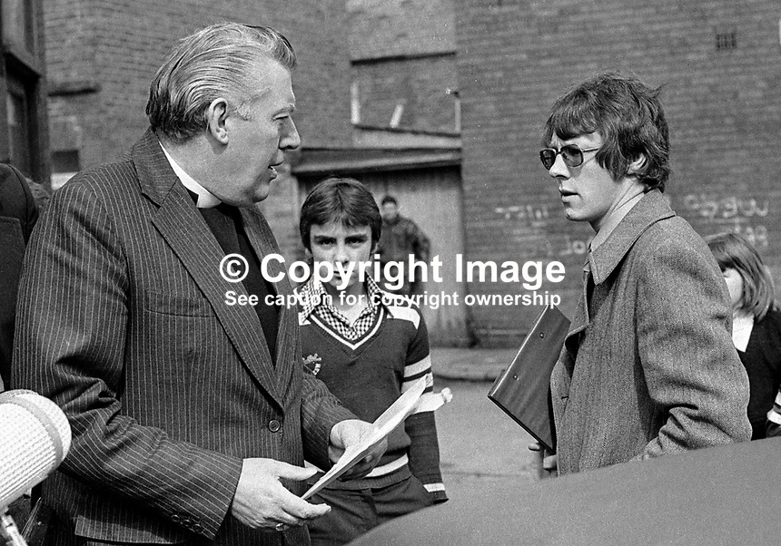 Rev Ian Paisley, left, speaking to a youthful Peter Robinson, outside the strike HQ of the UUAC, United Unionist Action Council, in Belfast, N Ireland, in May 1977,  LH 175/77, 197705000175c.<br />