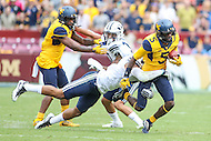 Landover, MD - September 23, 2016: West Virginia Mountaineers wide receiver Jovon Durante (5) gets tackled by a BYU Cougars defender during game between BYU and WVA at  FedEx Field in Landover, MD.  (Photo by Elliott Brown/Media Images International)