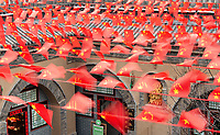 Chinese flags flutter over a courtyard at the Dikeyngyuan (pit yards) near Sanmenxia.