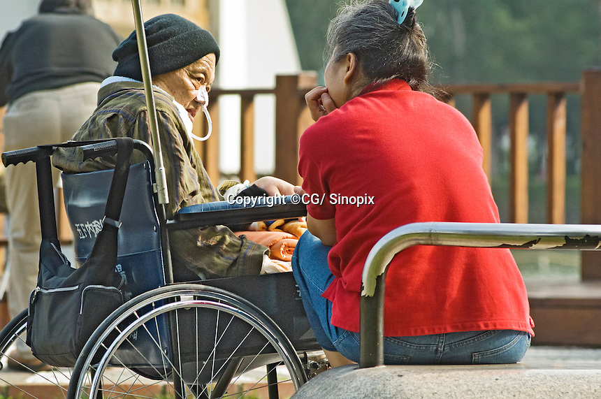 A patient sits outside a hospices in Taichung, Taiwan that is preyed upon by criminal betting syndicates that bet upon the the survival times of people with terminal cancer, Taichung, Taiwan.<br /> <br /> Please credit:  Sinopix