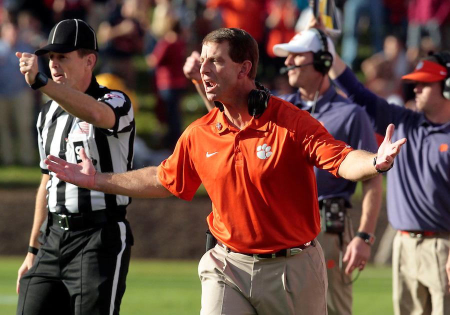 Clemson head coach Dabo Swinney reacts to a call during the game against Virginia Saturday at Scott Stadium in Charlottesville, VA. Clemson defeated Virginia 59-10.  Photo/Andrew Shurtleff