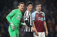 Newcastle United's Martin Dubravka, Newcastle United's Ki Sung-Yueng, Burnley's Jack Cork<br /> <br /> Photographer Rachel Holborn/CameraSport<br /> <br /> The Premier League - Burnley v Newcastle United - Monday 26th November 2018 - Turf Moor - Burnley<br /> <br /> World Copyright &copy; 2018 CameraSport. All rights reserved. 43 Linden Ave. Countesthorpe. Leicester. England. LE8 5PG - Tel: +44 (0) 116 277 4147 - admin@camerasport.com - www.camerasport.com