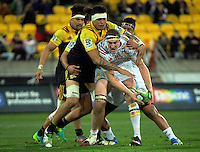 Brodie Rertallick tries to keep the ball from Vaea Fifita during the Super Rugby semifinal match between the Hurricanes and Chiefs at Westpac Stadium, Wellington, New Zealand on Saturday, 30 July 2016. Photo: Dave Lintott / lintottphoto.co.nz
