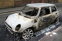A completely burnt out car in the London borough of Hackney. London saw the beginnings of riots on Saturday evening, after a peaceful protest in response to the shooting by police of Mark Duggan during an attempted arrest, escalated into violence. By the third night of violence, rioting and looting had spread to many areas of the capital and to other cities around the country.