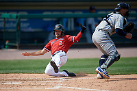 Rochester Red Wings center fielder Zack Granite (2) slides home safely during a game against the Columbus Clippers on August 9, 2017 at Frontier Field in Rochester, New York.  Rochester defeated Columbus 12-3.  (Mike Janes/Four Seam Images)