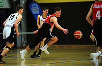 Action from the 2017 A Boys' Secondary Schools Basketball Premiership National Championship match between Greymouth High School (white) and Stratford High School (red white and black) at the B&M Centre in Palmerston North, New Zealand on Monday, 2 October 2017. Photo: Dave Lintott / lintottphoto.co.nz