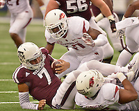 STAFF PHOTO BEN GOFF  @NWABenGoff -- 09/27/14 Arkansas linebacker Martrell Spaight, rear, and defensive end Trey Flowers sack Texas A&M quarterback Kenny Hill during the first quarter of the Southwest Classic at AT&T Stadium in Arlington, Texas on Saturday September 27, 2014.