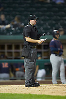 Home plate umpire A.J. Choc checks his lineup card during the Midwest League game between the Bowling Green Hot Rods and the Fort Wayne TinCaps at Parkview Field on August 20, 2019 in Fort Wayne, Indiana. The Hot Rods defeated the TinCaps 6-5. (Brian Westerholt/Four Seam Images)