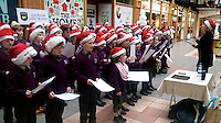 Children from Gael Scoil Faithleann Killarney pictured carol singing in the Killa rney Outlet Centre on Wednesday.<br /> Picture by Don MacMonagle