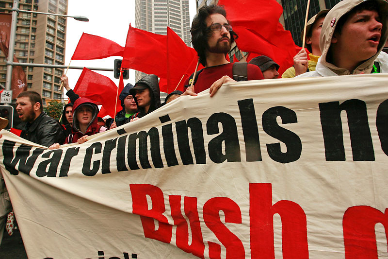 A group of protesters hold an anti-George W. Bush banner during an anti-APEC protests that coincided with APEC leaders week in central Sydney, Saturday, September 8 2007. Photo: Ed Giles.