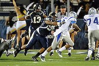 4 December 2010:  FIU defensive tackle Joshua Forney (96) and linebacker Toronto Smith (13) pursue Middle Tennessee quarterback Dwight Dasher (9) in the first quarter as the Middle Tennessee State University Blue Raiders defeated the FIU Golden Panthers, 28-27, at FIU Stadium in Miami, Florida.
