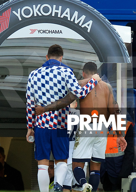 Theo Walcott of Everton (right) and Olivier Giroud of Chelsea leave the pitch after the Premier League match between Chelsea and Everton at Stamford Bridge, London, England on 11 November 2018. Photo by Alan  Stanford / PRiME Media Images.