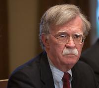 National Security Advisor John  Bolton listens to President Donald J. Trump make statements on the ongoing investigation of  election meddling and on the current situation in Syria during a meeting with senior military leadership at The White House in Washington, DC, March 9, 2018. <br /> CAP/MPI/RS<br /> &copy;RS/MPI/Capital Pictures