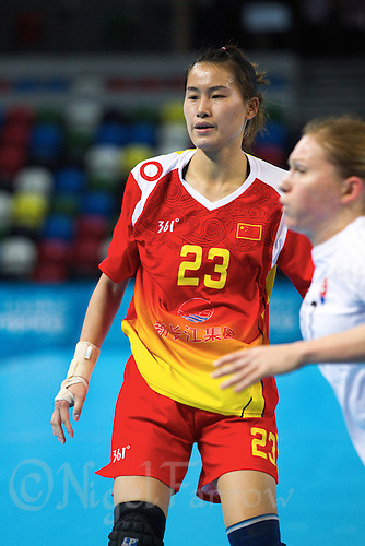 23 NOV 2011 - LONDON, GBR - China's Wu Yin (#23, in red and yellow) waits for the ball during the 2011 London Handball Cup match against Slovakia at The Handball Arena in the Olympic Park in Stratford, London  (PHOTO (C) NIGEL FARROW)