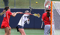 Penn State's  Madison Carter (24) scores her second goal against Ohio State goalkeeper Abigail Wise (10) and Shannon Rosati (36) on April 1, 2017. Carter scored six goals in No. 6 Nittany Lions' 16-12 win over the Buckeyes.  Photo/©2017 Craig Houtz
