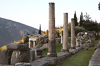 DELPHI, GREECE - APRIL 11 : A general view of the Stoa of the Athenians with the Athenian Treasury in the distance, on April 11, 2007 in the Sanctuary of Apollo, Delphi, Greece. The Stoa of the Athenians was erected circa 479BC after the victory of the Athenians in the naval battle of Salamis. The 3 Ionic columns were part of the Ionic stoa with 7 columns. (Photo by Manuel Cohen)