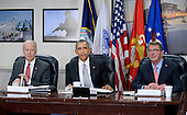 United States President Barack Obama flanked by Defense Secretary Ash Carter (R) and Vice President Joe Biden (L) holds a national security council meeting on the counter-ISIL campaign at the Pentagon December 14, 2015 in Arlington, Virginia. During the meeting President Obama received an update from his national security team and discussed ways to further enhance the campaign to degrade and destroy the terrorist group. <br /> Credit: Olivier Douliery / Pool via CNP