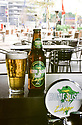 Home-brewed beer at the Homebush Bay Brewery, bar of Novotel Hotel at Olympic site, using Green and Golden Bell Frog logo.