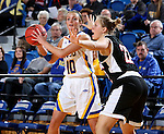 BROOKINGS, SD - JANUARY 7:  Kerri Young #10 from South Dakota State looks for a teammate past Mikaela Shaw #22 from the University of Nebraska Omaha during their game Saturday afternoon at Frost Arena in Brookings. (Dave Eggen/Inertia)