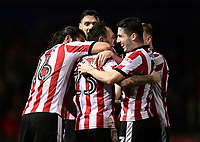 Lincoln City's Neal Eardley, centre, celebrates scoring the opening goal with team-mates Michael Bostwick, left, and Tom Pett<br /> <br /> Photographer Chris Vaughan/CameraSport<br /> <br /> The EFL Sky Bet League Two - Lincoln City v Cheltenham Town - Tuesday 13th February 2018 - Sincil Bank - Lincoln<br /> <br /> World Copyright &copy; 2018 CameraSport. All rights reserved. 43 Linden Ave. Countesthorpe. Leicester. England. LE8 5PG - Tel: +44 (0) 116 277 4147 - admin@camerasport.com - www.camerasport.com