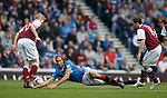 Bilel Mohsni takes a tumble between Arbroath's Alan Cook and Ross Chisholm
