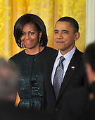 """United States President Barack Obama and first lady Michelle Obama arrive at the ceremony to honor recipients of the 2010 Medal of Freedom, """"the Nation's highest civilian honor presented to individuals who have made especially meritorious contributions to the security or national interests of the United States, to world peace, or to cultural or other significant public or private endeavors"""", in a ceremony in the East Room of the White House in Washington, D.C. on Tuesday, February 15, 2011..Credit: Ron Sachs / CNP"""