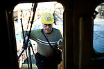 Union Pacific locomotive inspector Juan Schulz looks over a locomotive in a UP repair yard in Roseville, Calif., November 8, 2011. Schulz has worked at Union Pacific for seventeen years..CREDIT: Max Whittaker/Prime for The Wall Street Journal.HIRE