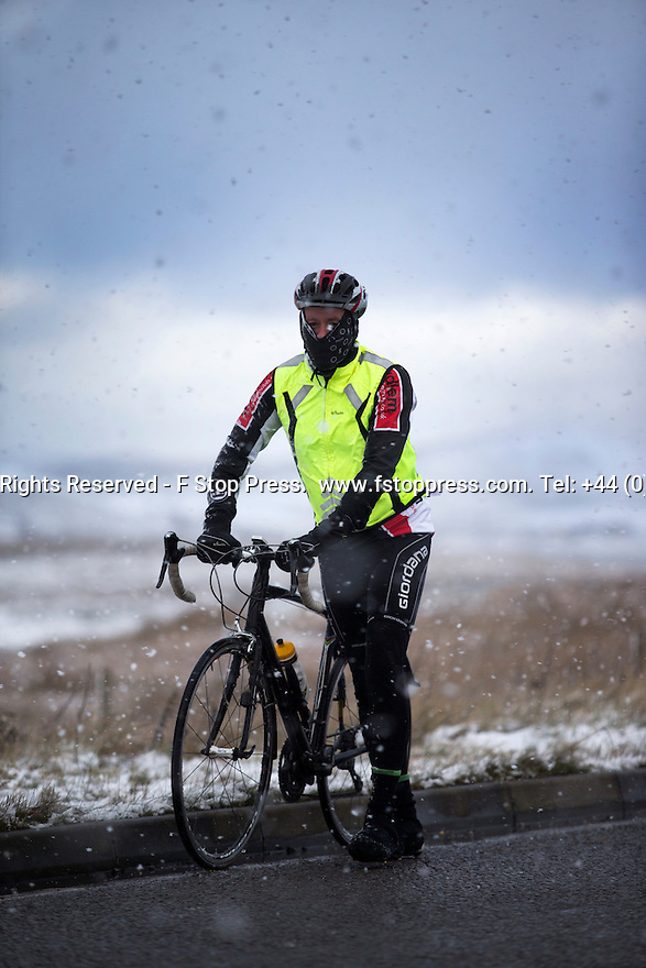 11/12/14<br /> <br /> A cyclist is forced to push his bicycle as high winds and snow make riding too difficult along the A53 between Buxton and Leek after overnight snow fall settles on hills in the Derbyshire Peak District.<br /> <br /> ***ANY UK EDITORIAL PRINT USE WILL ATTRACT A MINIMUM FEE OF £130. THIS IS STRICTLY A MINIMUM. USUAL SPACE-RATES WILL APPLY TO IMAGES THAT WOULD NORMALLY ATTRACT A HIGHER FEE . PRICE FOR WEB USE WILL BE NEGOTIATED SEPARATELY***<br /> <br /> <br /> All Rights Reserved - F Stop Press. www.fstoppress.com. Tel: +44 (0)1335 300098