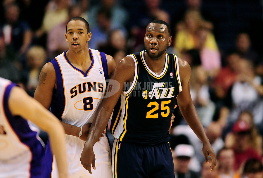 Oct. 12, 2010; Phoenix, AZ, USA; Utah Jazz center (25) Al Jefferson is defended by Phoenix Suns center (8) Channing Frye during a preseason game at the US Airways Center. Mandatory Credit: Mark J. Rebilas-