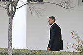 Washington, D.C. - March 6, 2009 -- United States President Barack Obama walks on the Colonnade of the White House en route to the Oval Office in Washington, D.C. on Friday, March 6, 2009 to the Oval Office. He is scheduled to make remarks at the Columbus (Ohio) Police Graduation Exercise later in the morning..Credit: Ron Sachs / Pool via CNP