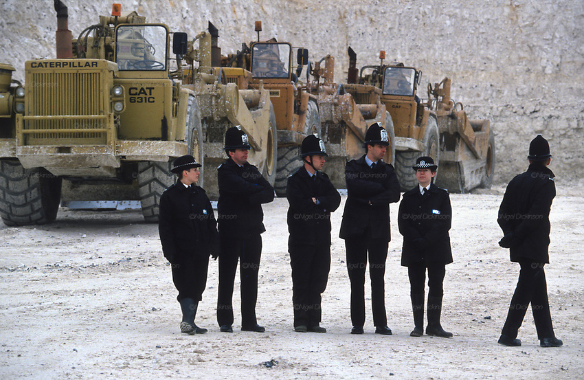 Police guard plant machinery in the Cutting. Road Protest actions at Twyford Down, near the Donga pathways, outside Winchester, against the M3 road extension. 1993<br />