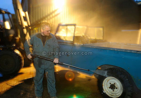 Mechanic steam cleaning a Series Land Rover. --- No releases available. Automotive trademarks are the property of the trademark holder, authorization may be needed for some uses.