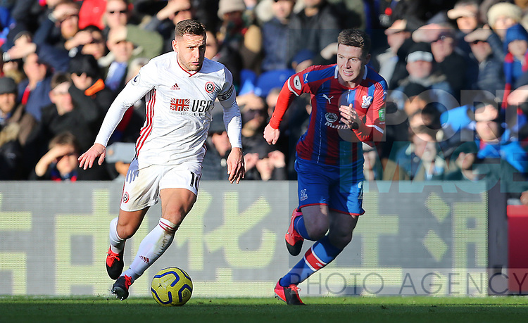 Sheffield United's Billy Sharp and Crystal Palace's James McCarthy during the Premier League match at Selhurst Park, London. Picture date: 1st February 2020. Picture credit should read: Paul Terry/Sportimage