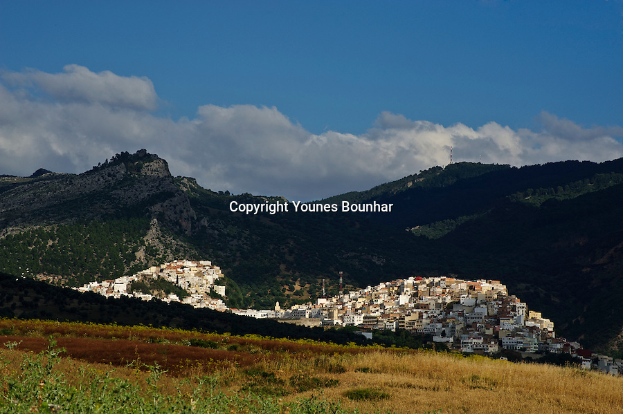 Beautiful, chiaroscuro dappled light bathing the village of Moulay Idriss Zerhoun the founding village of modern Morocco