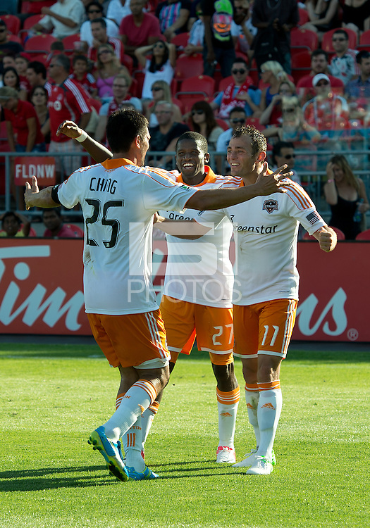 28 July 2012: Houston Dynamo forward Brian Ching #25,Houston Dynamo midfielder Brad Davis #11and Houston Dynamo midfielder Colin Clark #7 celebrate a goal by Houston Dynamo forward Brian Ching #25 during an MLS game between Toronto FC and the Houston Dynamo at BMO Field in Toronto,Ontario Canada..The Houston Dynamo won 2-0...