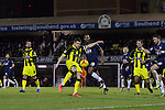 Southend United 1 Burton Albion 1, 22/02/2016. Roots Hall, League One. Visiting captain John Mousinho clearing the ball in the second-half as Southend United (in blue) took on Burton Albion in a League 1 fixture at Roots Hall. Founded in 1906, Southend United moved into their current ground in 1955, the construction of which was funded by the club's supporters. Southend won this match by 3-1, watched by a crowd of 6503. Photo by Colin McPherson.
