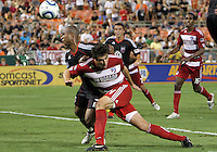 Julius James #2 of D.C. United heads the ball away from George John #14 of FC Dallas during an MLS match at RFK Stadium in Washington D.C. on August 14 2010. Dallas won 3-1.