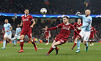 Liverpool's Andrew Robertson looks to control under pressure from Manchester City's David Silva<br /> <br /> Photographer Rich Linley/CameraSport<br /> <br /> UEFA Champions League Quarter-Final Second Leg - Manchester City v Liverpool - Tuesday 10th April 2018 - The Etihad - Manchester<br />  <br /> World Copyright &copy; 2017 CameraSport. All rights reserved. 43 Linden Ave. Countesthorpe. Leicester. England. LE8 5PG - Tel: +44 (0) 116 277 4147 - admin@camerasport.com - www.camerasport.com