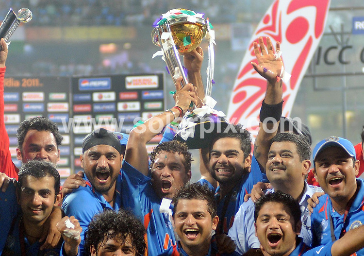 **ALL ROUND PICTURES FROM SOLARPIX.COM**                                             **WORLDWIDE SYNDICATION RIGHTS**                                                                                  Caption:  In a dramatic match, the Indian cricket team led by captain Mahendra Singh Dhoni clinched the tournament by six wickets at the Wankhede stadium in Mumbai to win the Cricket World Cup for only the second time having previously won it in London in 1983. .Throughout the land, people danced, let off fireworks and generally let themselves go as the tension of expectancy was released after the co-hosts had won cricket's greatest prize.                                                                             This pic: Indian cricket team                                                                                            JOB REF: 13075 SJA       DATE: 03_04_2011                                                           **MUST CREDIT SOLARPIX.COM OR DOUBLE FEE WILL BE CHARGED**                                                                      **MUST AGREE FEE BEFORE ONLINE USAGE**                               **CALL US ON: +34 952 811 768 or LOW RATE FROM UK 0844 617 7637**
