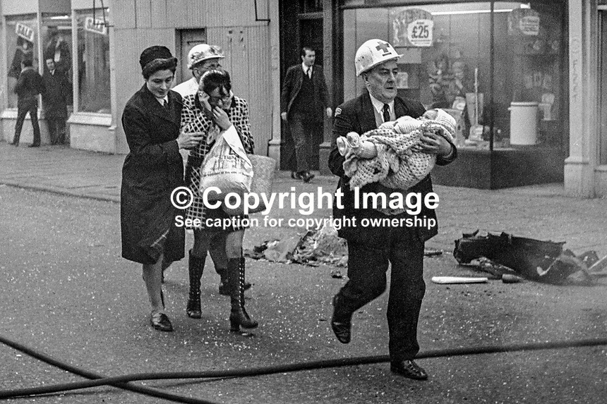 An ambulanceman carries an injured child from the scene of a Provisional IRA car bomb explosion in Bradbury Place, Belfast, N Ireland. An off-duty nurse and a paramedic escort the child's distraught mother. 197201210021b.<br /> <br /> Copyright Image from Victor Patterson, 54 Dorchester Park, Belfast, UK, BT9 6RJ<br /> <br /> t: +44 28 90661296<br /> m: +44 7802 353836<br /> vm: +44 20 88167153<br /> e1: victorpatterson@me.com<br /> e2: victorpatterson@gmail.com<br /> <br /> For my Terms and Conditions of Use go to www.victorpatterson.com