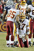 Landover, MD - December 27, 2009 -- Washington Redskins quarterback Jason Campbell (17) is helped to his feet after a sack by running back Quinton Ganther (35) in game action against the Dallas Cowboys at FedEx Field in Landover, Maryland on Sunday, December 27, 2009..Credit: Ron Sachs / CNP.(RESTRICTION: NO New York or New Jersey Newspapers or newspapers within a 75 mile radius of New York City)