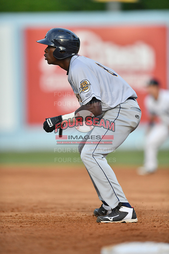 Charleston RiverDogs center fielder Estevan Florial (8) leads off first base during a game against the Asheville Tourists at McCormick Field on July 5, 2017 in Asheville, North Carolina. The RiverDogs defeated the Tourists 10-9. (Tony Farlow/Four Seam Images)