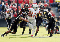 Ohio State Buckeyes running back Ezekiel Elliott (15) runs through the tackle attempt by Purdue Boilermakers safety Taylor Richards (4), right, and defensive back Frankie Williams (24) during the third quarter of the NCAA football game at Ross-Ade Stadium in West Lafayette, Ind. on Nov. 2, 2013. (Adam Cairns / The Columbus Dispatch)
