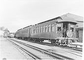 End-side view of parlor car &quot;Chama&quot; with San Juan drum head in consist with 2 coaches.<br /> D&amp;RG  Alamosa, CO