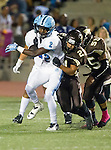 Torrance, CA 10/02/15 - Dayshawn Littleton (Carson #2) and Michael Timmerman (West #21) in action during the Carson-West Torrance CIF varsity football game at West Torrance High School.  Carson defeated West Torrance 34-27.